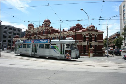 Melbourne tram with building in background